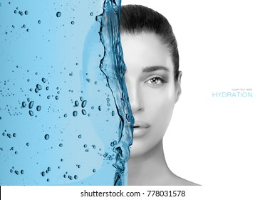 Monochrome greyscale face portrait of a beautiful woman half obscured by a wave of blue in a cropped view isolated on white for a beauty and skin care concept.