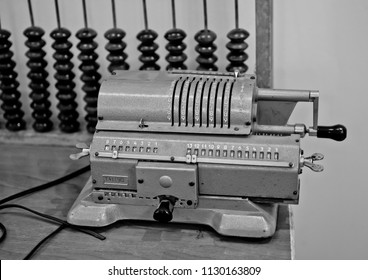 Monochrome image. Abacus and an old mechanical counting machine.