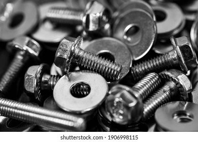 Monochrome image, bolts washers and nuts close up macro shot for industrial background.