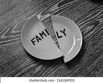 Monochrome image. Broken plate with the inscription family. Concept of divorce.