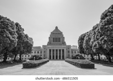 A monochrome image of the distinctive granite stone tower with a pyramid-shaped dome of the National Diet Building of Japan, the seat of the national government in Tokyo.