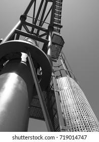 monochrome image of a dockside industrial crane