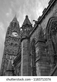 monochrome image of the historic rochdale town hall in lancashire a historic gothic building with tall clock tower ornate stone carvings and gargoyles