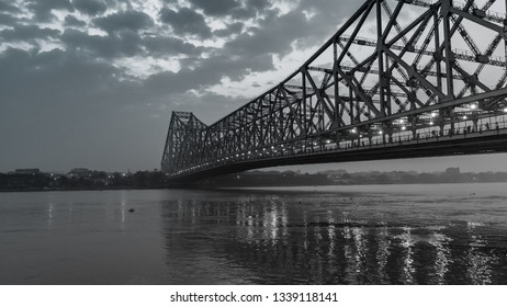 Monochrome Image of  Howrah Bridge at the time of Sunrise. Howrah Bridge is a bridge with a suspended span over the Hooghly River in West Bengal.