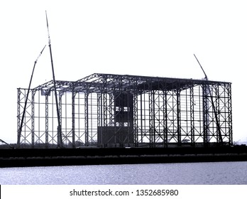 Monochrome image of a large steel structure construction