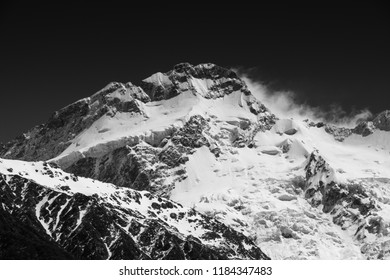 Monochrome image of summit of Mount Sefton with spindrift blowing Mount Cook/Aoraki National Park, New Zealand