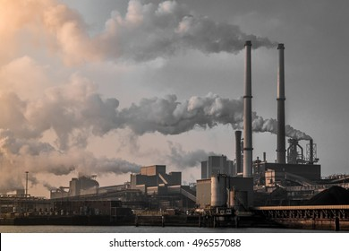 Monochrome industrial landscape smoke from the chimneys, an old factory