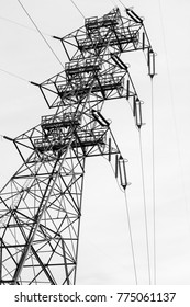 Monochrome photo of a electrical transmission tower and electrical lines