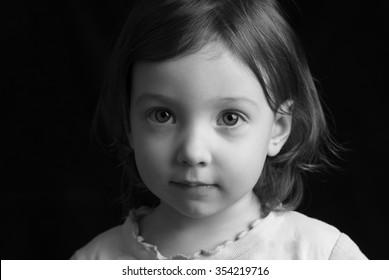 monochrome portrait of a child on a black background
