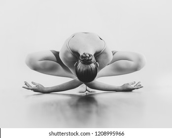 Monochrome portrait of female classical dancer posing in studio black and white copy space text. Girl ballerina dancing beautiful posture flower isolated background no face. Fine art card choreography