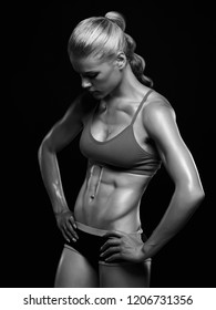 monochrome portrait of fitness girl. gym concept. muscular woman, trained female body