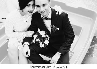 monochrome portrait of married couple in boat