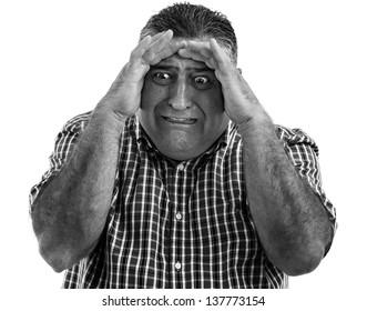 Monochrome portrait of a terrified man