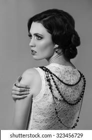 Monochrome portrait of woman representing Coco Chanel