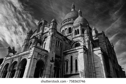 Monochrome scenic and dramatic outdoor architectural image of the famous church / basilica Sacre Coeur Montmartre (Sacred Heart), Paris, France, with a view towards a blue sky