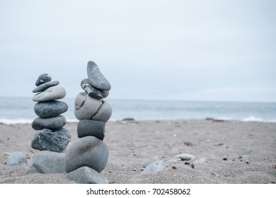Monochrome, Serene, Blue Stacked rocks on a California beach symbolizing Peace, Balance, Meditation, and Mindfulness with Room for Copy