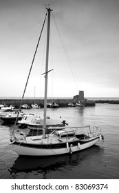 Monochrome shot of some boats in the Scottish harbour of Dunure, Ayrshire.