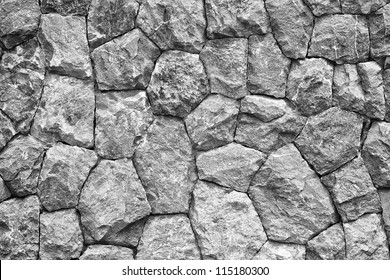 monochrome shot of stone wall texture background