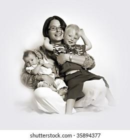 Monochrome studio shot of loving mother holding babies