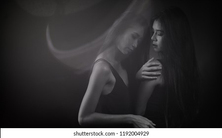 Monochrome two desperate woman try to touch each other to understand feeling down, Portrait of Slim Asian Women black straight hair holding hands body, Abstract high low exposure contrast shadow
