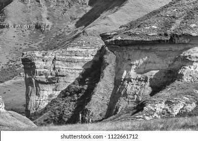 Monochrome view of the Brandwag and Mushroom Rock, two sandstone buttresses at Golden Gate in the Free State Province of South Africa