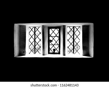 Monochrome window background, Tudor window with lead diamond shape. Single pane glass, old three section window. Natural light and thick walls. Black and white art design window.