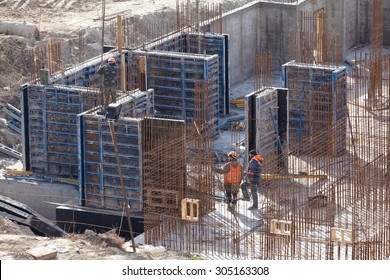 Monolithic frame construction of the building. Solid walls of concrete. The framework for the walls. Formwork for walls made of concrete. Construction of the building.