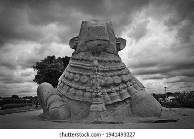 Monolithic stone statue of Nandi, the divine bull and vehicle of Lord Shiva, in Lepakshi, Andhra Pradesh, India