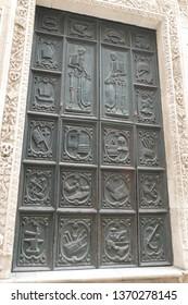 MONOPOLI, ITALY - APR 11, 2019 -Detail of doors of the Purgatory church, Monopoli, Puglia, Italy