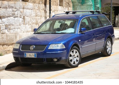 MONOPOLI, ITALY - MAY 29, 2017: Volkswagen Passat blue station wagon car parked in Italy. There are 41 million motor vehicles registered in Italy.