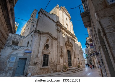 Monopoli, Puglia, Italy - 01 March, 2019: The church Fraternal Organization of our Lady of Suffrage (Purgatory church) with The skeleton entrance door in old town. Apulia