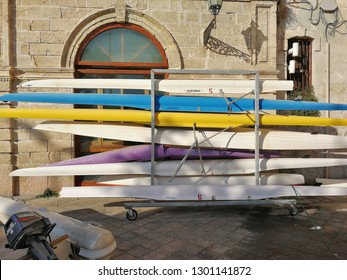 Monopoli, Puglia, Italy - September 8, 2018: Rack of colored canoes at the Cala Batter dock