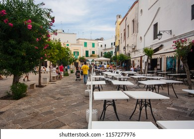 Monopoli/Italy - 12 August 2015: Restaurants on the street of old village in Monopoli