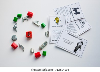 Monopoly board game, playing pieces, cards on white background