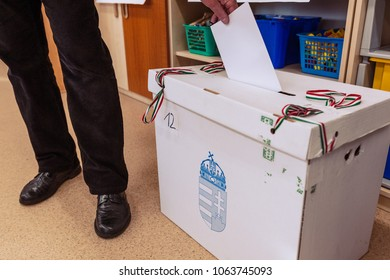 Monor, HUNGARY - April 08, 2018: The hand of man putting his vote in the ballot box. Election in Hungary.