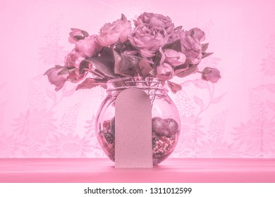Monotone pink bouquet of flowers, retro style image.