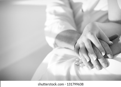 monotone shot of couple holding hands