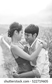 Monotone young beautiful couple in love on road