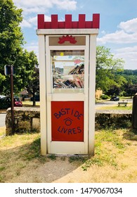 Monpazier, France 18 July 2019; Small library or book exchange in an old telephone box in the French town of Monpazier. Bastide livres translates to Bastide books.