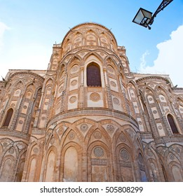 The Monreale Cathedral built in mix of different styles - Byzantine, French, Norman and Arab, it's apse decorated with stone carving and inlay, Sicily, Italy.