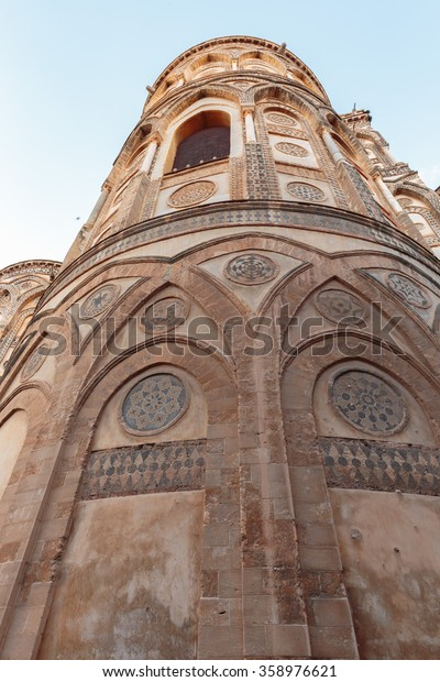 MONREALE, ITALY - JANUARY 05 2016: Outdoor Cathedral of Monreale. Warm Winter January. Travel and Tourist Destination. Christian Catholic Medieval Architecture