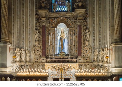 Monreale, Sicily, Europe-10/06 / 2018.Altar of the Virgin Mary with the child Jesus in the cathedral Santa Maria Nuova of Monreale with several angels holding candles near Palermo in Sicily