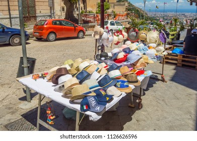 Monreale, Sicily, Europe-10/06 / 2018.Small shop with two tables selling hats and caps in the city of Monreale near Palermo in Sicily