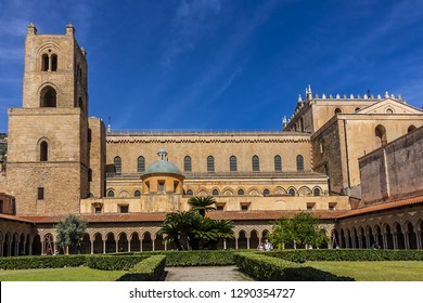 MONREALE, SICILY, ITALY - SEPTEMBER 28, 2018: Cloister of Roman Catholic Cathedral of Monreale (or Duomo di Monreale, 1267) near Palermo; one of the greatest extant examples of Norman architecture.