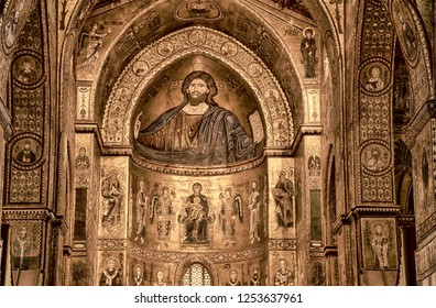MONREALE, SICILY - NOV 28, 218 - Mosaic of Christ Pantocrator over the main altar of Cathredral Monreale, Sicily, Italy