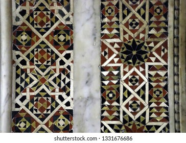 MONREALE, SICILY - NOV 28, 218 - Detail of inlaid marble Islamic patterns on walls of the  Cathredral Monreale, Palermo, Sicily, Italy