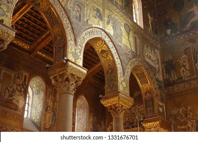 MONREALE, SICILY - NOV 28, 218 - Inlaid  mosaics and carvings on  columns of Cathredral Monreale, Palermo, Sicily, Italy