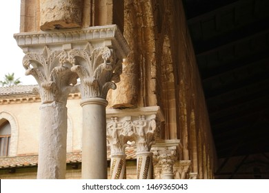 MONREALE, SICILY - NOV 28, 218 - Inlaid marble mosaics on slender columns of the cloister of Cathredral Monreale, Palermo, Sicily, Italy