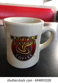 MONROE, LA, USA - AUGUST 12, 2017: A mug of hot black coffee is served for breakfast in Waffle House, which is an American restaurant chain with more than 2,100 locations in 25 states nationwide.