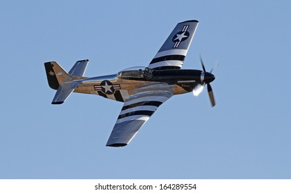 MONROE, NC - NOVEMBER 10:  World War II P-51 Mustang Fighter Performing during Warbirds Over Monroe Air Show in Monroe, NC, on November 10, 2013.